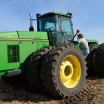 Tom Haag climbs aboard his John Deere 8970 tractor to start tilling rented land last fall near Eden Valley. Newer tractors have enclosed cabs and rollover protection, but many farmers still use older tractors that don't have safety equipment.
