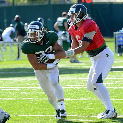 MSU running back Nick Tompkins takes a handoff from