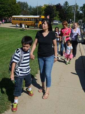 Chie Davis and her son, Luke Davis, a second-grade student at Westlake Elementary School in the Lakeview district, walk home from school last week. Davis said the recent changes in Lakeview's busing policy did not affect her family.