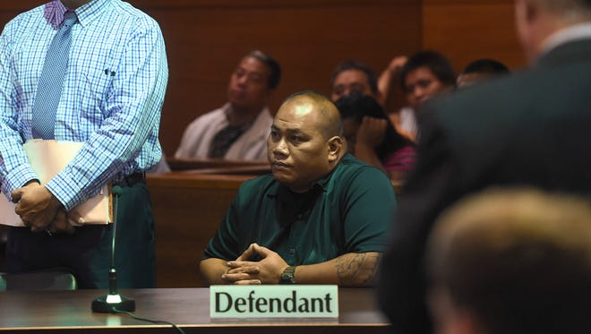 In this Oct. 9 file photo, Department of Corrections Officer Gerry Hocog, seated, and his attorney Joaquin Arriola, Jr., attend a court hearing at the Superior Court of Guam in Hagåtña. Arriola on Wednesday asked the court for a separate trial for Hocog.