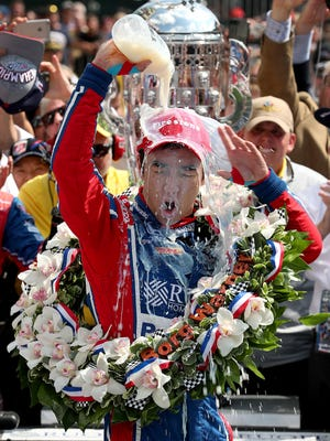 Andretti Autosport IndyCar driver Takuma Sato (26) celebrates winning the 101st running of the Indianapolis 500 at Indianapolis Motor Speedway Sunday, May 28, 2017.