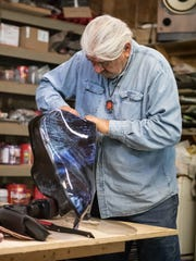 When not working on caskets or wooden urns, Bill Vandegriff works on his Harley motorcycle.