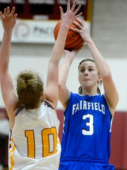 Fairfield's Jill Barta shoots a jump shot over Belt's Kara Gerke last season in Belt.