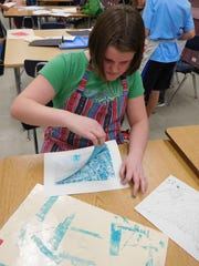 Logan Riedle reveals her butterfly print in art class