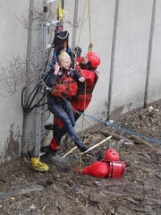 Rochester Fire Department rescued a woman from the Genesee River near St. Paul Street.
