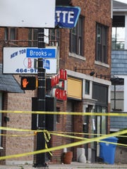 Police did not know if the people who had been shot had come from the bar across the street.