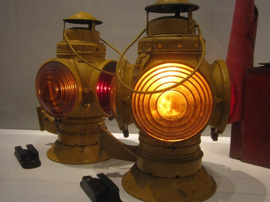 Kerosene lamps with colored lenses like this were used to illuminate trains before electric lighting.