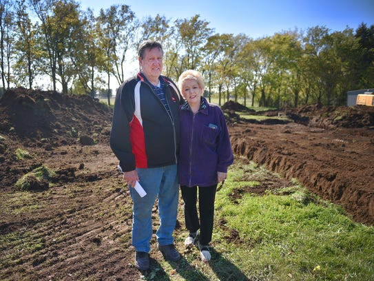 Douglas Lee and Sherry Dee Johnson stand on 35 acres