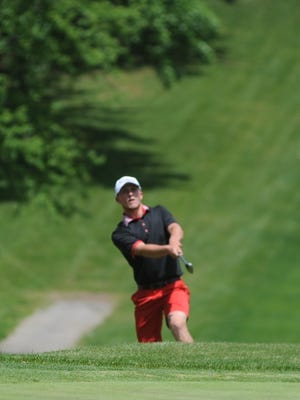 Richmond's Garrett Byrd chips a shot onto the No. 18 green during the boys golf sectional at Forest Hills Country Club Monday, June 6, 2016.