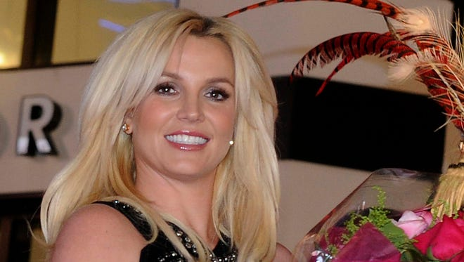 """Singer Britney Spears arrives at Planet Hollywood Resort & Casino before the debut of her new Las Vegas residency """"Britney: Piece of Me"""" on Tuesday, Dec. 3, 2013."""