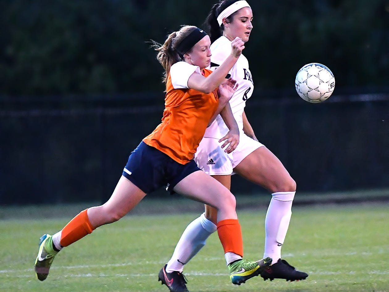 Franklin senior defender Madison Smith cuts off Dickson County's Kelsie Wall during the opening round of the District 11-AAA Tournament.