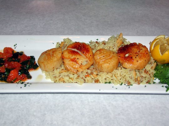 The Oceans Alive jumbo sea scallop dish, ready to be served at Oscar Rose Steak and Seafood House in Coshocton.