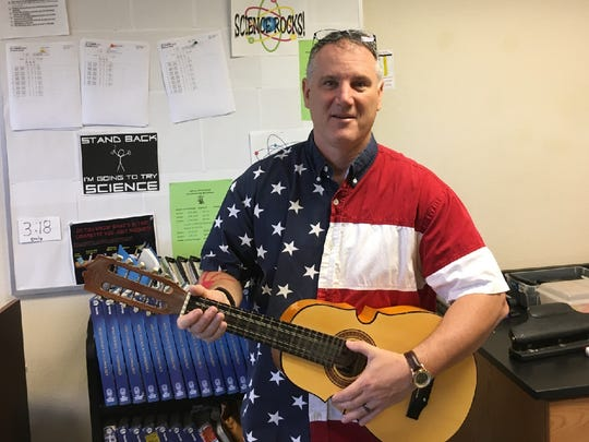 Jefferson Middle School science teacher Scott Guisbert loves country music, and incorporates it into his lessons.