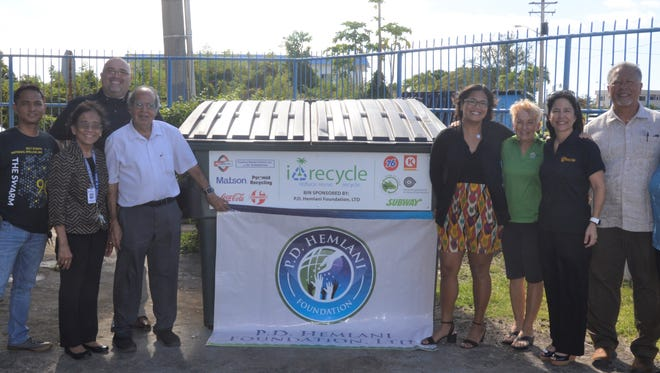 i*recycle unveils new recycling bin at St. Anthony School with representatives from P.D. Hemlani Foundation. Pictured from left: Resty Reyes, St. Anthony School; Lorena Chaco, St. Anthony School Principal; Jojo Camacho, Ambros, Inc.; Vashi Hemlani; P.D. Hemlani Foundation; Elicia Santo Tomas, P.D. Hemlani Foundation; Peggy Denney, i*recycle; Patricia Salas, Bank of Guam; Mark Sablan, South Pacific Petroleum Corporation; and Gloria Perez, Matson Navigation Company.