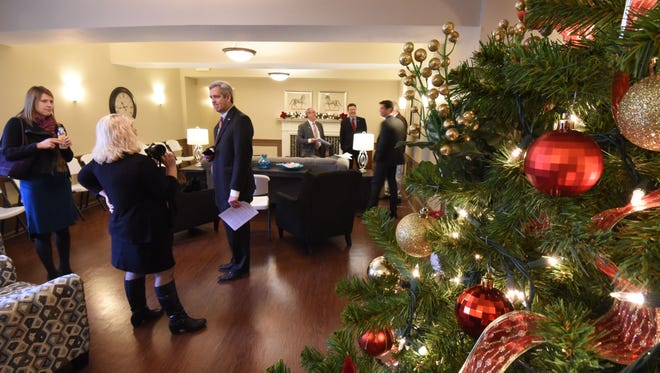 Visitors tour the Central Hotel on Monday morning. The building at 10 Public Square in Galion is now low-income housing for senior citizens.