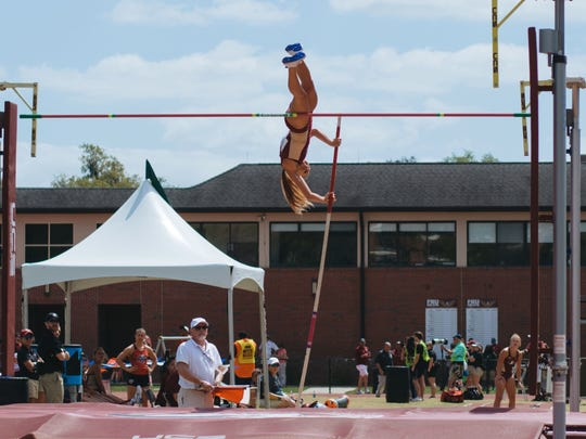 Florida State redshirt freshman pole vaulter Amanda Lewis makes a soaring jump during the FSU Relays at Mike Long Track.
