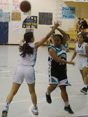 Southern High senior Kimberly Malalis throws a pass during the the Dolphins' Independent Interscholastic Athletic Association of Guam Girls' Basketball League road game against the Academy of Our Lady of Guam Cougars on Friday, Nov. 27.