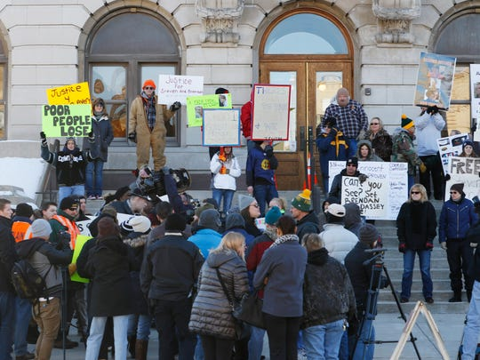 Supporters, from near and far, of convicted killer Steven Avery and his nephew, Brendan Dassey, gather on the north side of the Manitowoc County Courthouse to protest on Friday, Jan. 29. Some counter-protester were also present.