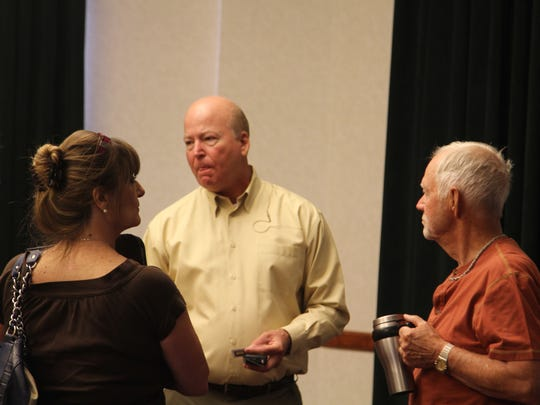 Roger Brooks talks to residents after presenting his findings of the Cedar City downtown business area on August 19, 2016.