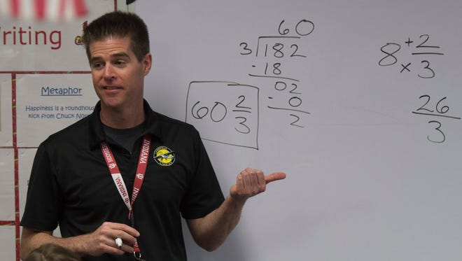 Ryan Harris works out some fraction problems with his fifth grade class at Lynnville Elementary on Wednesday, April 18, 2018. Harris has been a teacher for 17 years, 14 of those years at Lynnville.