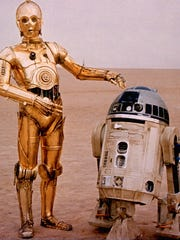 Anthony Daniels wore a full-body suit to play C-3PO (left), a character who appears in every 'Star Wars' film. R2-D2 (the late Kenny Baker, right) is Artoo's best bud.