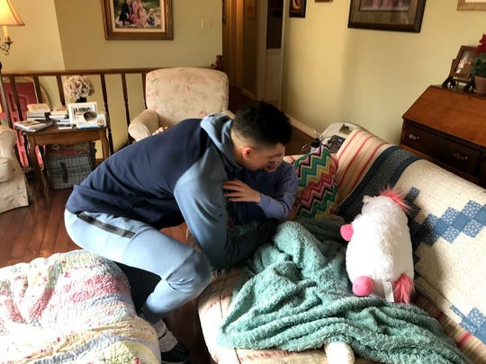 "Michael Porter Jr. gives Elizabeth Joy ""Lizzy"" Wampler a hug while visiting her at her home."