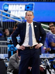 Florida Gulf Coast coach Joe Dooley reacts to an official's