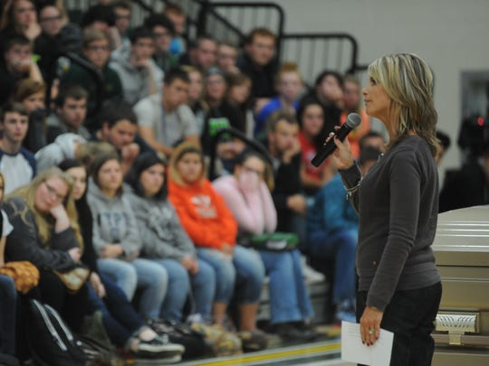 Tracie Upchurch talks to Northeastern students about her son's struggle with drug addiction.