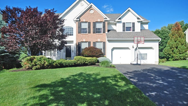 This four-bedroom manor home at 6 Hickory Lane in Green Brook will be open from 1 to 4 p.m. today, Oct. 11.