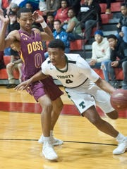 Trinity guard Jay Scrubb drives aroundDoss guard LaQuay