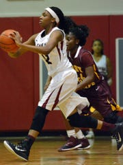 Pineville's Daryale Bayonne (42, front) looks to pass over Natchitoches Friday, Jan. 23, 2014.-Melinda Martinez/mmartinez@thetowntalk.com The Town Talk Gannett