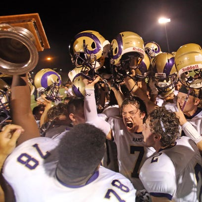 Clarkstown North celebrates their 26-8 win over Clarkstown