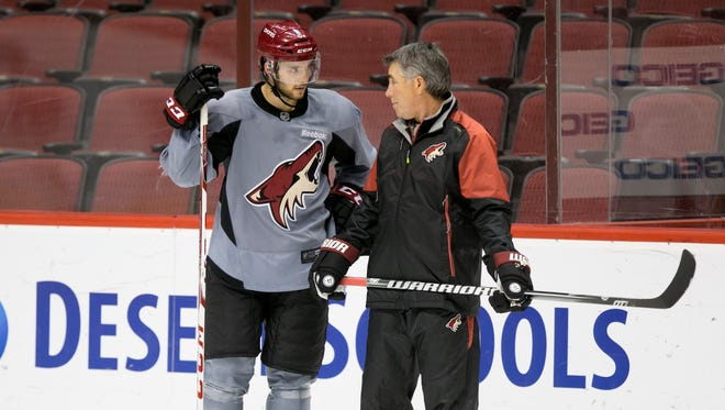 Coyotes winger Tobias Rieder talks to Coyotes head coach Dave Tippett  during practice at the Gila River Arena on Thursday, October 1, 2015.