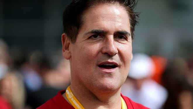 Dallas Mavericks owner Mark Cuban walks the red carpet before the start of the Indianapolis 500 at the Indianapolis Motor Speedway, Sunday, May 25, 2014, in Indianapolis.