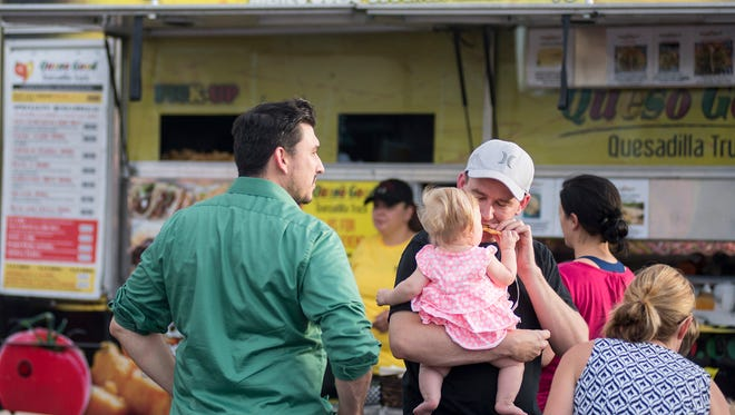 (From left to right) John Muthart, Thomas Muthart, Natalie Muthart (8 months) and Jackie Terrel enjoy   Chandler's Food Truck Friday event on Friday, July 17, 2015.
