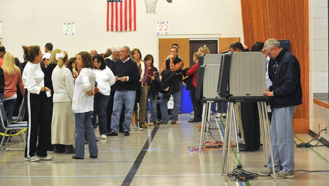 Voters lined up in the Parish Hall at Holy Spirit Catholic Church at Geist in Hamilton County, Ind., on Nov. 6, 2012.