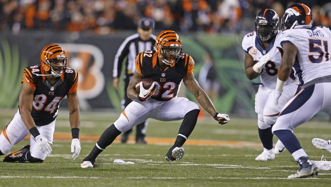 Cincinnati Bengals running back Jeremy Hill (32) makes a curt as he runs against the Denver Broncos during the second quarter of their game played at Paul Brown Stadium.