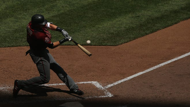 Nick Ahmed #13 of the Arizona Diamondbacks flies out in the fifth inning against the Milwaukee Brewers at Miller Park on May 23, 2018 in Milwaukee, Wisconsin.