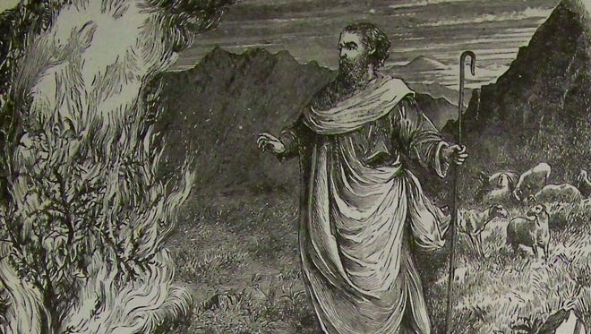 """""""Moses and the Burning Bush"""" is an illustration from the 1890 Holman Bible."""