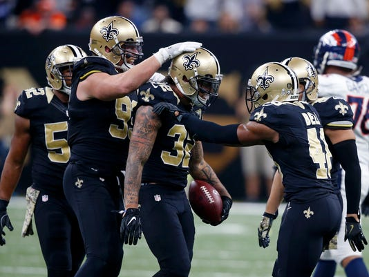 FILE -  In this Sunday, Nov. 13, 2016 file photo, New Orleans Saints strong safety Kenny Vaccaro (32) celebrates his interception with defensive end Paul Kruger (99) and free safety Vonn Bell (48) in the second half of an NFL football game in New Orleans. The New Orleans Saints' defense has gradually gone from looking like a lost cause to an aggressive-minded asset during the course of the season. (AP Photo/John McCusker, File)