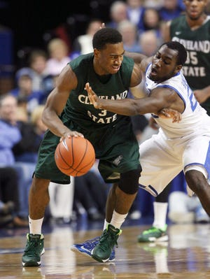 Nov 25, 2013; Lexington, KY, USA; Cleveland State Vikings guard Trey Lewis (3) dribbles the ball against Kentucky Wildcats guard Dominique Hawkins (25) at Rupp Arena. Kentucky defeated Cleveland 68-61. Mandatory Credit: Mark Zerof-USA TODAY Sports