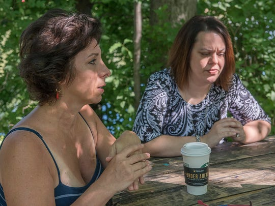 Rachelle Vartanian (left) quit her job and sold her home to start the Living and Learning Enrichment Center for autism. She and her assistant director, Pam Travis, discuss the center.
