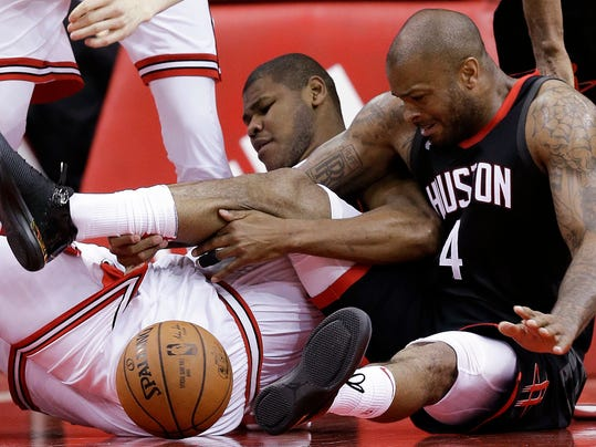 Houston Rockets forward PJ Tucker (4) and Chicago Bulls center Cristiano Felicio vie for a loose ball during the first half of an NBA basketball game Tuesday, March 27, 2018, in Houston. (AP Photo/Eric Christian Smith)