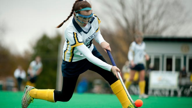 Essex's Tiffany Barnes (14) hits the ball during the Division I field hockey state championship game between Hartford and Essex at Moulton/Winder field last season.