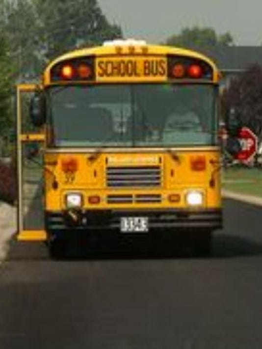 636123903223373529-636095312649797311-1411662806000-school-bus-with-stop-sign.jpg