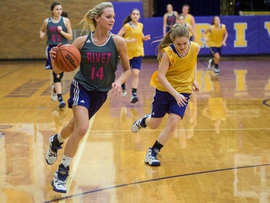 Rivet's Grace Waggoner (14) drives the ball down the