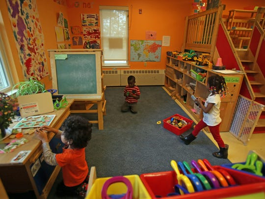 Children play in their classroom at the day care center
