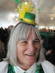 Beth Wathen, Greenwood, enjoys a St. Patrick's Day celebration in a tent outside McGinley's Golden Ace on East Washington Street on March 17, 2014.