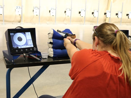 "Katie Buzdor, of Toledo, practices firing with an air pistol the ""Women on Target"" course at the Gary Anderson CMP Competition Center at Camp Perry on Saturday."