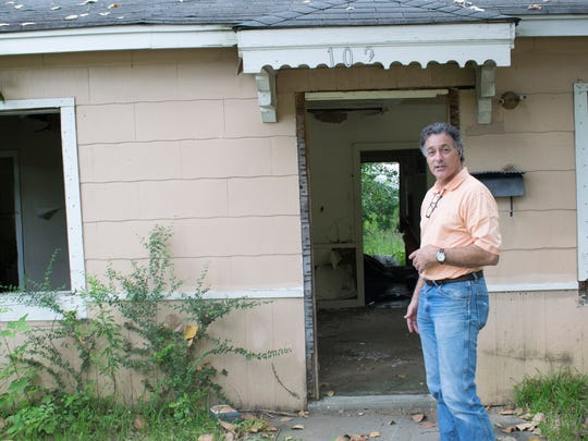 In 2017, Pete Sarullo, founder of Construction Ministries, standing in front  on a home in west Jackson.